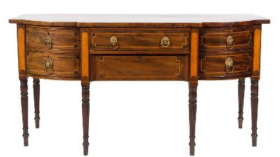 Of Royal Interest - A Regency mahogany and satinwood inlaid sideboard, of bowed breakfront outline, bordered with boxwood and ebony lines and with boss ornament, fitted with a central frieze and recessed apron drawer flanked by a deep drawer to either side, between satinwood pilaster stiles on ring turned and reeded tapered legs, 183cm (6ft) long.