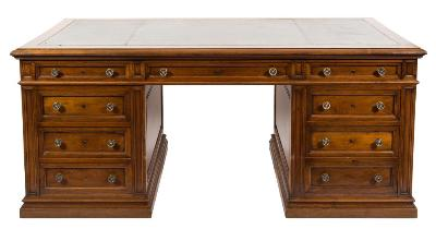 An Edwardian walnut pedestal desk, of large size, the top with a moulded edge, inset with a triple divided panel of green tooled leather, containing three frieze drawers, the pedestals with three short drawers to one side and a single short and a deep drawer to the other, having fielded panels to the reverse on moulded plinth bases, the top 180.5cm (5ft 11in) x 100.5cm (3ft 3 1/2in).