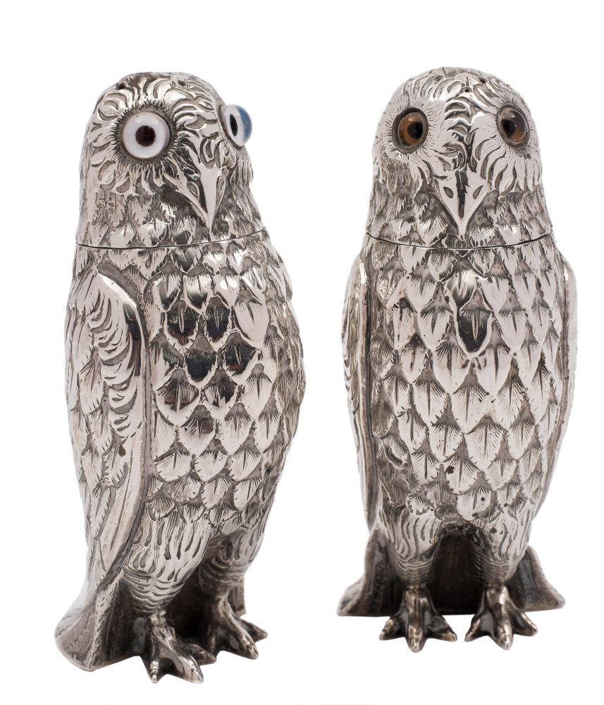 Sale FS38; Lot: 0109: A pair of Victorian silver novelty pepperettes, maker George Unite, Birmingham, 1876? in the form of owls, with inset glass eyes, 9cm high, 4.17ozs.