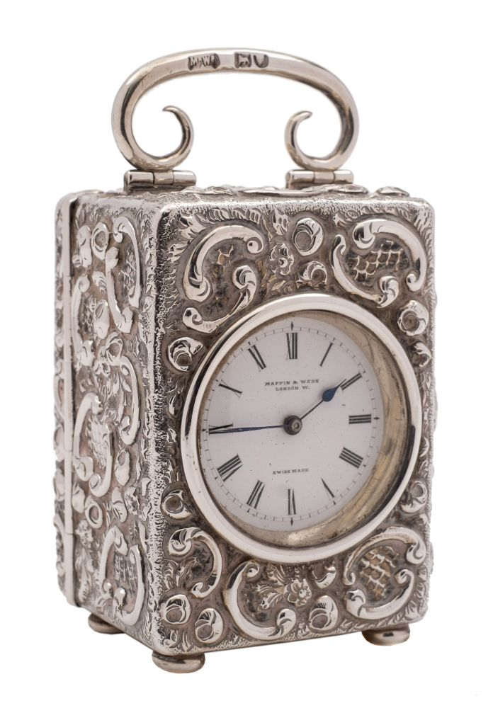 Sale FS38; Lot: 0125: A late Victorian silver boudoir timepiece, maker Mappin & Webb, London, 1899 the 3.5cm Roman dial signed Mappin & Webb, the movement with lever platform escapement contained in an embossed rectangular silver case with loop carrying handle, raised on bun feet, 9cm high.