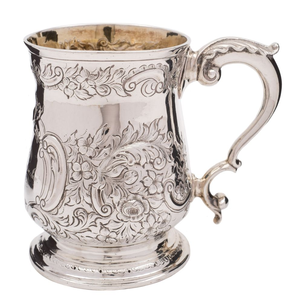 Sale FS38; Lot: 0161: A George III silver mug, maker's mark worn, London, 1803 inscribed, of baluster form with later embossed foliate and scroll decoration, acanthus capped scroll handle, raised on a spreading circular foot, 11cm high, 10.87ozs.