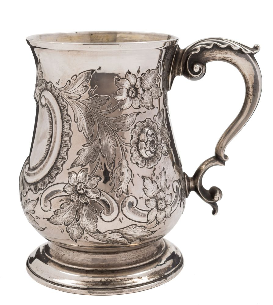 Sale FS38; Lot: 0186: A George III silver mug, maker Benjamin Bickerton, London, 1764 of baluster form with embossed foliate decoration, acanthus capped scroll handle raised on a circular spreading foot, 13cm high, 394gms, 12.69ozs.