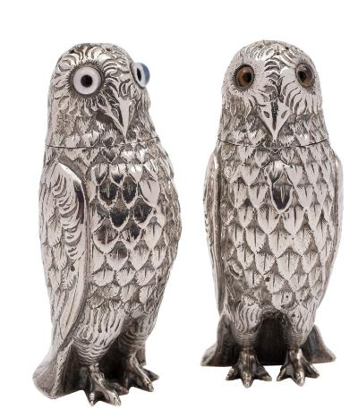 A pair of Victorian silver novelty pepperettes, maker George Unite, Birmingham, 1876? in the form of owls, with inset glass eyes, 9cm high, 4.17ozs.