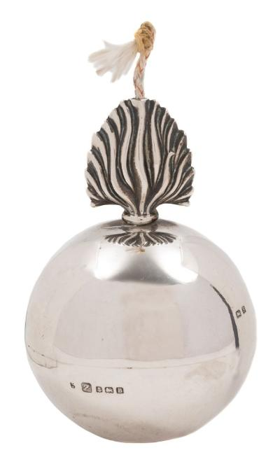 A George V silver novelty cigar lighter, maker A & J Zimmerman, Birmingham, 1926in the form of a flaming grenade, 6.5cm diameter.