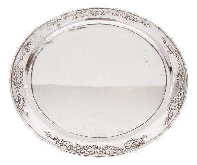 Sale FS38; Lot: 0146: A Chinese silver circular salver, bears finesse mark of circular outline with prunus blossom decorated border, raised on three ball feet, 37.5cm diameter, 51.41ozs.