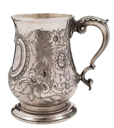 A George III silver mug, maker Benjamin Bickerton, London, 1764 of baluster form with embossed foliate decoration, acanthus capped scroll handle raised on a circular spreading foot, 13cm high, 394gms, 12.69ozs.