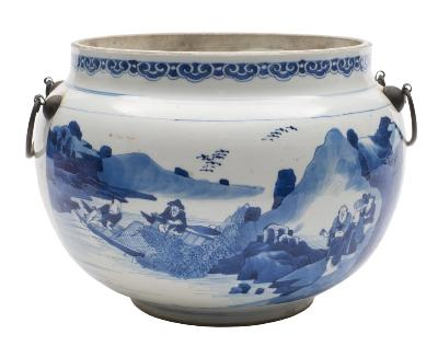 Sale FS38; Lot: 0516: A Chinese porcelain bowl of squat globular form painted in blue with a panel containing two figures, a deer and crane in front of a waterside shrine and verso with travellers beside a lake flanked by a ruyi head sceptre below a lappet band, with metal handles, concentric circles to base, Kangxi, 24cm diameter [cover lacking, minor stain towards base].