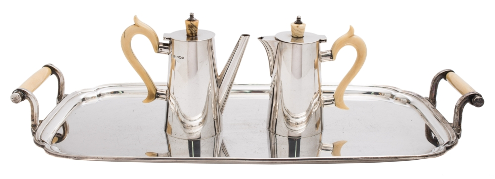 Sale FS39; Lot: 0009: A George v silver two-piece coffee service and tray maker Viner's Ltd, Sheffield, 1933/35 the coffee pot and water jug of plain tapering form with ivory finials and handles, the tray of rectangular outline with re-entrant corners, with ivory carrying handles, 51cm wide. overall weight 2100gms, 67.52ozs.