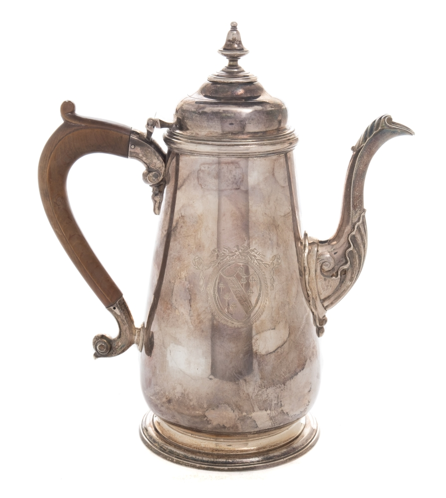 Sale FS39; Lot: 0093: A George II chocolate pot maker William Parry, Exeter, 1747 crested, of tapered cylindrical form, the domed hinged lid with removable urn finial, acanthus decorated spout and wood scroll handle, raised on a circular spreading foot, 25cm high. 885gms, 28.48ozs.