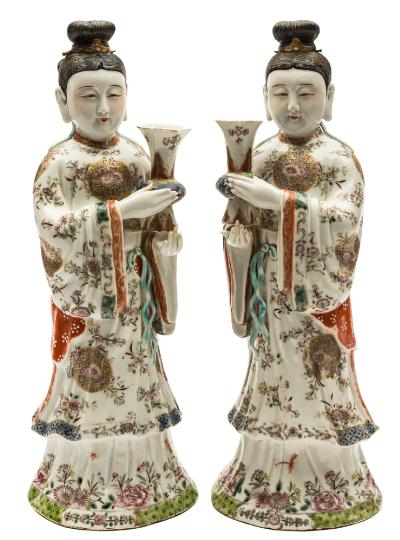 Sale FS39; Lot: 0443: A pair of Chinese famille rose figures of court ladies holding Gu-shaped vases, their elaborate flowing robes enamelled with floral sprays and medallions, 20th century, 38cm [with padded cases].