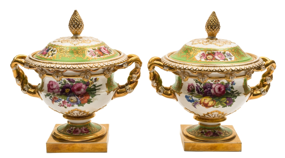 Sale FS39; Lot: 0537: A pair of English porcelain 'Warwick' vases and covers probably Coalport, with pinecone finials, the shoulders with entwined vine branch handles and pendant bunches of grapes, painted with floral sprays on a gilded bright green ground, circa 1820-30, 22cm high [one finial re-attached].