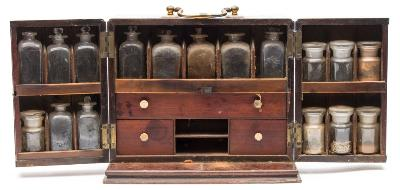 Sale FS39; Lot: 0592: A 19th century mahogany medicine cabinet the hinged double-front enclosing an arrangement of pigeonholes and drawers, containing glass bottles, balance scales and other accessories, including hand written remedies for ailments, with concealed compartment to the rear containing four clear glass bottles, 31cm wide.