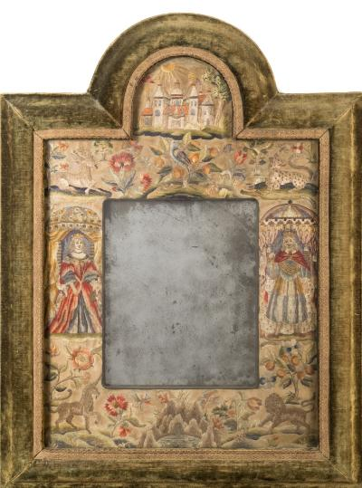 Sale FS39; Lot: 0594: A Charles II embroidered mirror frame of arched outline, the rectangular mirror plate enclosed by an embroidered silkwork border depicting Charles and Catherine of Braganza under marital canopies, with sunshine over a palace to the arch, stag, leopard, unicorn and lion to the corners and flowering shrubs, birds and insects all worked with coloured silks within a velvet lined cushion frame, 78cm x 59 cm.