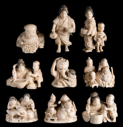Sale FS39; Lot: 0626: A collection of nine Japanese carved and stained ivory okimonos figural subjects, including Budai, mothers and children and a boy with an octopus, late Meiji/Taisho, 3-5cm high.