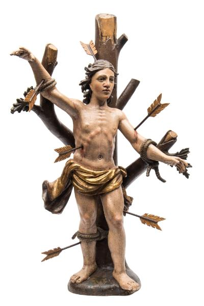 Sale FS39; Lot: 0699: A carved wood and polychrome decorated figure of St Sebastian the semi-naked figure tied to a tree and pierced with arrows in his arms, legs, head and side, overall height 86cm.