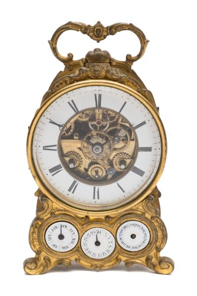 Sale FS39; Lot: 0730: Grignon Meusnier, a French mantel clock with calendar the eight-day duration movement striking the hours and half-hours on a bell with an outside countwheel, the backplate stamped with the maker's details Grignon Meusnier, Paris, Breveté, 117, the skeletonised dial having a white enamelled chapter ring with black Roman numerals and blued-steel moon hands, with the balance to the movement visible within the centre along with a silvered alarm setting disc and winding arbor, with three further subsidiary dials set below within the case depicting the day, month and date, the gilt-metal case of scroll form and surmounted by a cast matching handle, the case numbered 117 and stamped with the initials GM to the decorative rear, height 19cm * Biography the founder Pierre Grignon is recorded as working in Paris from the mid-18th century. by circa 1860 the business was known as Grignon Meusnier recorded at rue Charlot 60in the heart of the clockmaking region of the city. in 1853 they had been granted a patent for the fitting of a movement pendulum (balance).