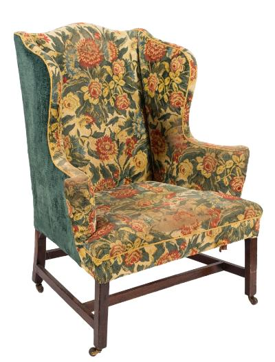 Sale FS39; Lot: 0791: A George III mahogany wing frame armchair, fully upholstered in floral foliate tapestry, having outswept arm supports, on square chamfered legs, united by stretchers, terminating in castors.