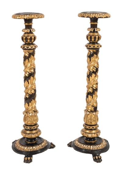 Sale FS39; Lot: 0825: A pair of Regency carved giltwood and ebonised jardiniere stands, the circular tops with acanthus borders on turned, fluted and spiralling acanthus columns with circular bases and tripod claw feet, the tops 27cm (10 3/4in) diameter, 118cm (3ft 10 1/2in) high.