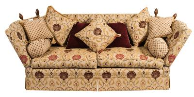 Sale FS39; Lot: 0878: A contemporary Brights of Nettlebed knole settee, with drop ends, fully upholstered in William Morris style foliate and peacock fan cream ground fabric, complete with loose cushions and bolsters and on castors, 208cm (6ft 10in) long.