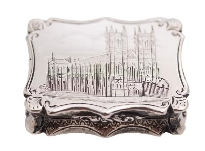 Sale FS39; Lot: 0077: A Victorian silver vinaigrette, maker Nathaniel Mills, Birmingham, 1842 of rectangular outline, the hinged lid engraved with a view of Westminster Abbey, having a pierced foliate decorated gilt grille, 3.25cm.