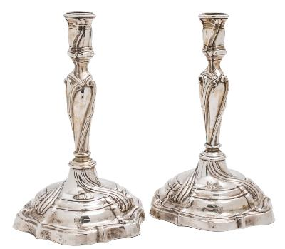 Sale FS39; Lot: 0086: A pair of German silver candlesticks of wrythen form with urn-shaped nozzles on knopped stems and circular domed bases, Augsburg 1761-63, maker A S., 24cm high, 950gms, 30.54ozs.