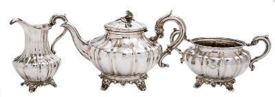 A matched silver three-piece tea service, various maker's and dates of fluted melon-shaped outline, raised on swept foliate feet, the teapot, makers mark worn, London, 1803, the two-handled sugar basin, maker John James Keith, London, 1848, and the cream jug, maker Henry Holland, London, 1855, total weight of silver 1348gms, 43.37ozs.