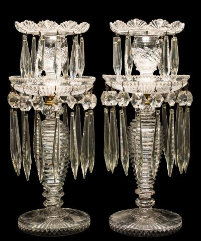 A pair of 19th century cut glass table lustres of circular two-tiered form hung with pendants and prismatic drops, 33cm high.