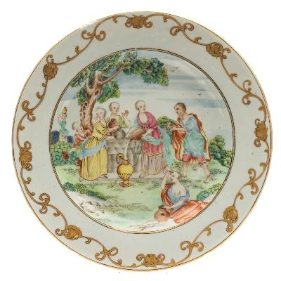 Sale FS39; Lot: 0430: A Chinese famille rose Biblical subject plate painted with 'Rebecca at the Well' pouring water into a golden ewer, Abraham's servant Eliezer to one side and surrounded by five women holding pitchers, the rim with iron-red and gilt scrollwork, Qianlong, 23cm diameter [a rim chip and fritting].