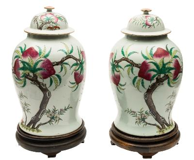 Sale FS39; Lot: 0441: A pair of large Chinese famille rose 'peach' vases and covers of baluster form with domed covers, painted with iron-red bats and large peaches growing from leafy knarled branches, further branches of blossom and lingzhi fungus below, 43cm and wood stands.