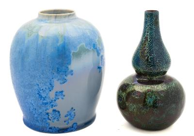 Sale FS39; Lot: 0505: A Royal Doulton 'Flambe' double gourd vase and a Ruskin-style art pottery vase the first decorated overall in red, green and blue speckled glazes, printed mark, 14.5 cm; the second with an attractive blue, grey and green crystalline glaze, impressed numerals, 14 cm.