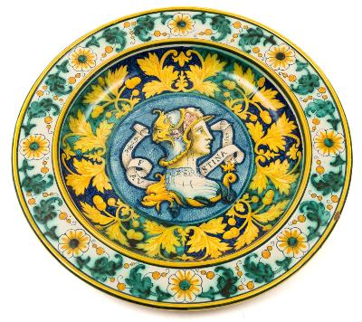 Sale FS39; Lot: 0511: A Cantagalli majolica charger painted in the 16th century Deruta manner with a head and shoulders portrait inscribed 'Faustina 1522' within borders of flowers and foliage, oak leaves and acorns, 48cm diameter [minor rim chip].