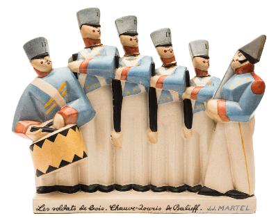 Sale FS39; Lot: 0514: Joel and Jan Martel (1896-1966) a pottery figure group of Les soldats de bois modelled after the original by Fau et Gilliard at Boulogne sur Seine, impressed marks to base and incised facsimile signature, circa 1921-25, 35cm wide, [cracked with glue repair to four necks].