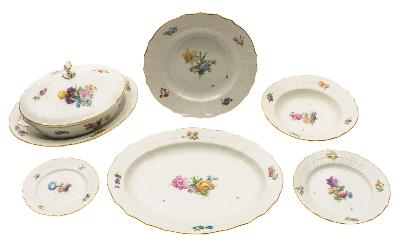 Sale FS39; Lot: 0563: An extensive Copenhagen ozier-moulded porcelain part dinner service painted with floral sprays and sprigs, underglaze blue wave and printed factory marks, comprising: twelve dinner plates 25cm, eleven plates 20cm, twelve plates 16cm, twelve deep plates 22cm, three circular bowls 21cm, two tureens and covers 27cm, four oval dishes 31 and 36cm, one shaped square section dish 21cm and two small square section dishes 12 cm; together with three similar dishes [total 64 pieces].