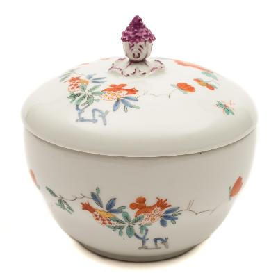 Sale FS39; Lot: 0567: A Meissen sucrier and cover with flower bud finial, painted in the Kakiemon palette with floral sprays, underglaze blue Marcolini crossed swords and star mark, 12.5cm high.