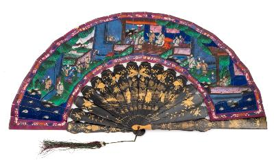 Sale FS39; Lot: 0595: A Cantonese black lacquer and paper fan the painted paper leaf decorated with figures with ivory faces set in a garden landscape, with black lacquer and gilt decorated sticks and guards. 28cm long.