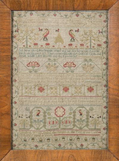 A mid 18th century needlework sampler with banded verse, flowering shrub and bird decoration, enclosed by a strawberry meandering border, worked in coloured silks of blues, greens, yellow, red and ivory by Elizabeth Wyth 1755, aged 13 years, 30 x 21cm.