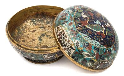 Sale FS39; Lot: 0603: A Chinese cloisonne enamel bowl and cover of globular form with flared footrim, decorated overall with panels containing a qilin, phoenix, cranes, bats, clouds, flowers and foliage on turquoise, deep blue, yellow and white grounds, 17th century, 18cm diameter [minor damage and losses].