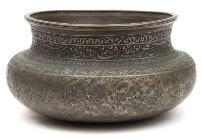 Sale FS39; Lot: 0655: A Persian Safavid tinned copper bowl of rounded form with waisted neck, engraved and chased with bands of foliage and calligraphy, probably 17th/18th century, 25cm diameter.