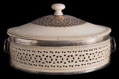 Sale FS39; Lot: 0681: A Victorian ivory and silver mounted casket, maker Edward Brown, London, 1882 of oval outline, with shallow domed lift-off lid, with turned finial and pierced silver mount, the sides with pierced stellar decoration, with silver ring handles and rim, 20cm wide.