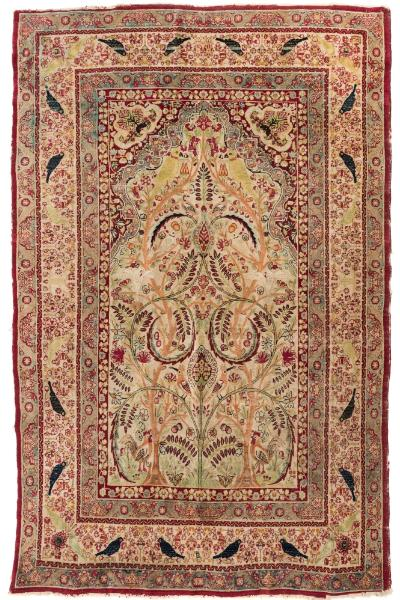An Isfahan prayer rug, the beige mihrab with an all over design of birds amidst flowering trees and stems, enclosed by a main beige similar border, 195cm x 142cm.