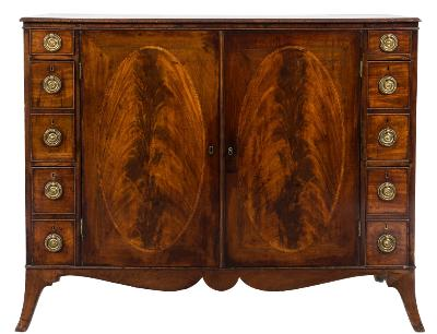 A George III mahogany rectangular side cabinet, the top with a moulded edge, the central cupboard fitted with adjustable shelves and enclosed by a pair of satinwood crossbanded and boxwood and ebony strung oval panel doors, flanked by two small, two deep and two lead lined cellarette drawers, having a shaped apron base, on splayed bracket feet, 128cm (4ft 2 1/2in) length, 48cm (1ft 9in) depth, 98cm (3ft 2 1/2in) height.