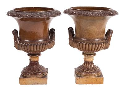 Sale FS39; Lot: 0905: By Hexter and Humpherson & Co, Newton Abbot - A pair of salt glazed stoneware twin-handled garden urns, of campagna shape with reeded edges, half reeded bodies and fluted socles with square plinths, 50cm (1ft 7 3/4in) high, 38cm (1ft 3in) diameter (the columns restored).