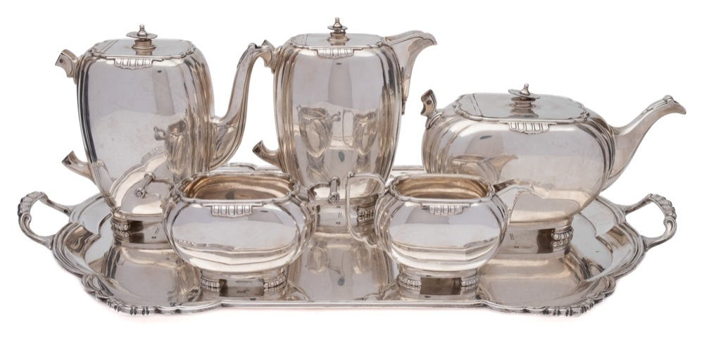 Sale FS40; Lot: 0012: An Elizabeth II silver six-piece tea and coffee service, maker Mappin & Webb, Sheffield, 1959 of ovoid form with reeded angles, raised on beaded feet, includes tea pot, coffee pot, hot water pot, cream jug, sugar basin and rectangular serving tray with loop carrying handles, total weight of silver 4646gms, 149.38ozs.