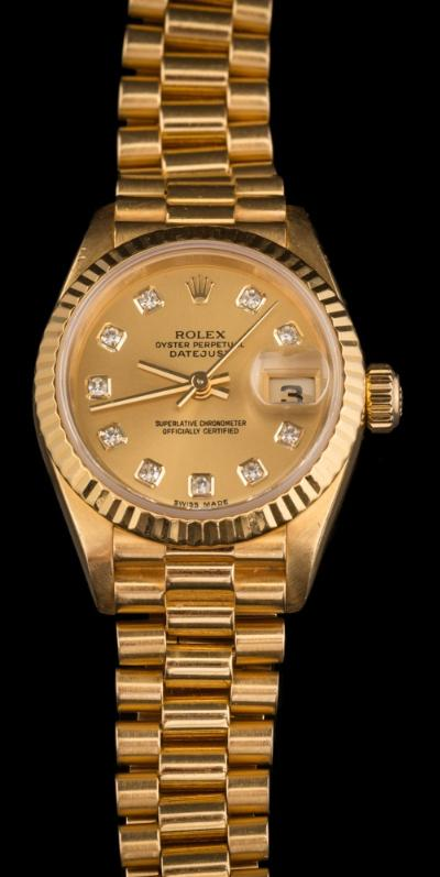 Sale FS40; Lot: 0139: Rolex. A lady's diamond-set, 18ct yellow gold 'Rolex Oyster Perpetual Datejust wristwatch the gold coloured, circular dial with diamond markers, centre seconds hand and magnified date aperture in a gold case numbered '69178' and '414386' between the lugs on a tapering 'President' bracelet, contained in original red leather covered case with box and together with original bill of sale dated 24/11/95, guarantee and booklets.