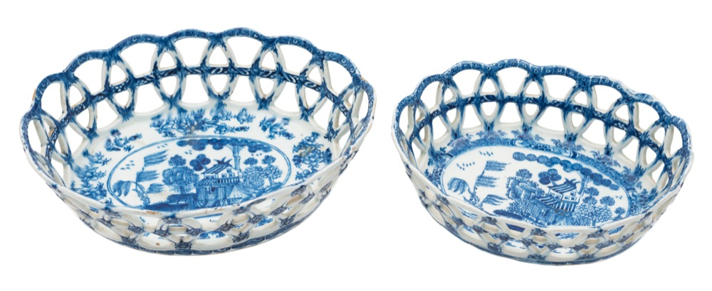 Sale FS40; Lot: 0612: Two Bow blue and white oval baskets of flared lattice work form, each interior painted with matching Chinese landscapes, one with a double line border, the other diaper and floral, circa 1765, 18 and 21cm wide [minor damage to the larger basket].