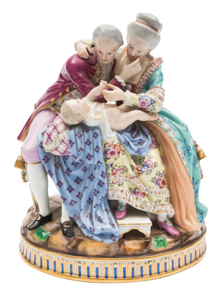Sale FS40; Lot: 0632: A Meissen family group 'The Lucky Parents' after the model by Michel Victor Acier, the mother and father in eighteenth century costume, seated on a tasselled banquette admiring their baby, an older child behind them, on oval mound base, underglaze blue crossed swords mark with incised model no.E81, late 19th century, 22cm high [some damage and losses].