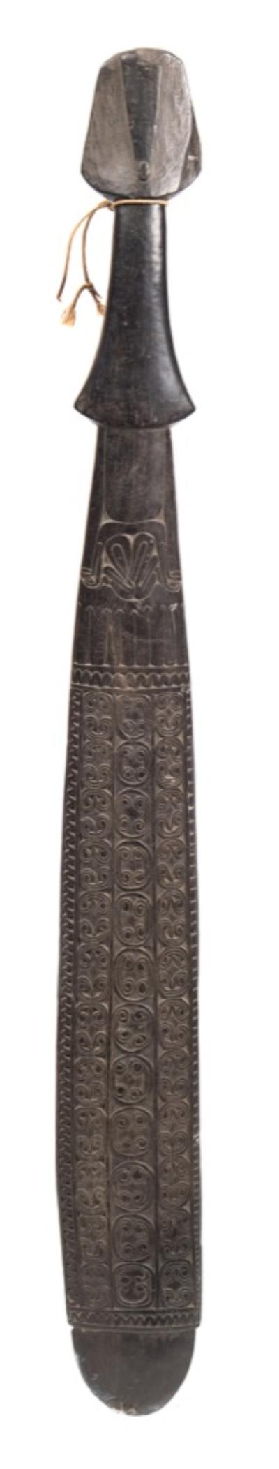 Sale FS40; Lot: 0716: A Trobriand Island club the flattened blade decorated with incised rows of geometric scrolling motifs and bird decoration, the shaped hilt of spade -shaped outline, overall length 79cm.