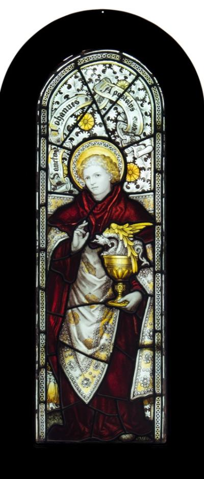 Sale FS40; Lot: 0777: A 19th century stained glass panel, depicting Saint John the Apostle of arched outline, the Saint holding a chalice containing a serpent, inscribed above 'Sanctus Johannes Apostolus', contained in a stained wood frame, size of panel 101 x 34cm.