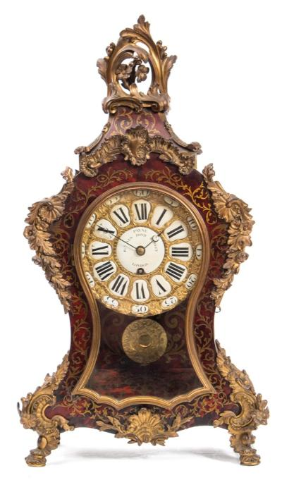 Sale FS40; Lot: 0812: Payne, London a boulle bracket clock the eight-day duration, single fusee timepiece movement having an anchor escapement and engraved to the backplate Payne, 163 New Bond St., the round gilt-brass dial with raised decoration and having black Roman numerals to individual shaped cartouches, the enamelled centre signed Payne, 163 New Bond Street, London with blued steel moon hands, the waisted boulle case with engraved inlaid brass decoration to the maroon tortoiseshell, with applied brass mounts and surmounted by rococo decoration, with a glazed front door and sides, height 58cm * Biography William Payne is first recorded at 62 South Moulton Street, London in 1816. by 1825 he had moved to 163 New Bond Street becoming William Payne & Company at that address in 1852.