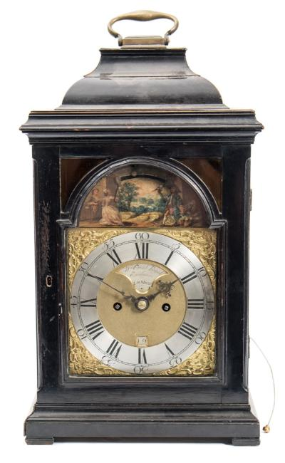 Sale FS40; Lot: 0813: William Creak, Royal Exchange London, an automaton bracket clock the eight-day duration, five-pillar, double-fusee movement having a verge escapement and striking the hours on a bell, with pull-repeat of the last hour at will, with a fully engraved backplate of floral and c-scroll decoration and engraved with the maker's name Wm. Creak, Royal Exchange, London, the brass break-arch dial having a raised silvered chapter ring engraved with black Roman numerals and Arabic outer five-minute markings, with the matted dial centre having a date aperture and inset silvered plaque engraved with a repeat of the maker's signature, with blued steel hands, the arch having a well-painted depiction of a couple in period dress playing badminton within a garden setting with the two racquets moving in sequence as the shuttlecock moves between the two as the clock ticks, the inverted bell-top ebonised case having curved canted corners, coloured glass to the two apertures above the arch of the dial, further decorative glass apertures to the sides, a brass carrying handle to the top and standing on ebonised pad feet, height 47.5cm, handle down, 51.5cm, handle up. * Biography William Creak was a well-regarded maker working in London from circa 1740 until at least 1775, being at the Royal Exchange from 1754. He made a number of fine musical and automata clocks for the Eastern Export market. There are examples of his clocks and watches in various museums including the Victoria and Albert Museum, the Science Museum, South Kensington and the Amsterdam Museum.